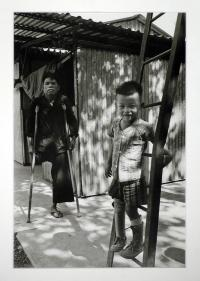 artists/Durrance, Richard/thumb/Durrance, Richard - Boy Who Lost Both Legs in Saigon Rehab Center.jpg