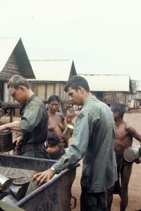artists/Ricks, Ned/thumb/Ricks, Ned - Cav Troopers Share Chow with Montagnard Villagers, 1971.jpg